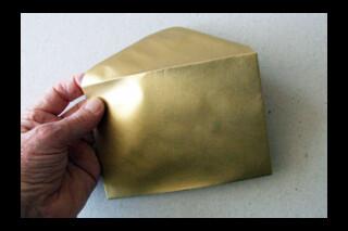 C6 golden coloured envelope