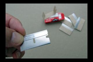 Safety, single sided, razor blade